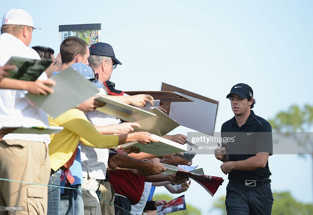 Rory McIlroy of Northern Ireland signs autographs during the pro am of the Honda Classic at PGA National on February 27, 2013 in Palm Beach Gardens, Florida.
