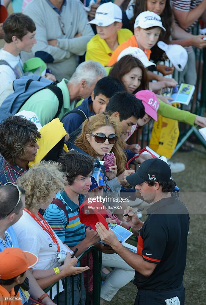 Rory McIlroy of Northern Ireland signs autographs during the second round of the 142nd Open Championship at Muirfield on July 19, 2013 in Gullane, Scotland.