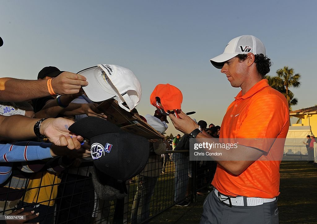 Rory McIlroy of Northern Ireland signs autographs for fans during the second round of the World Golf Championships-Cadillac Championship at TPC Blue Monster at Doral on March 8, 2013 in Doral, Florida.