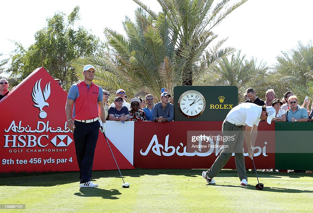 Rory McIlroy of Northern Ireland (R) slumps after hitting his tee shot on the 9th hole as Martin Kaymer of Germany (L) waits during the second round of The Abu Dhabi HSBC Golf Championship at Abu Dhabi Golf Club on January 18, 2013 in Abu Dhabi, United Arab Emirates.
