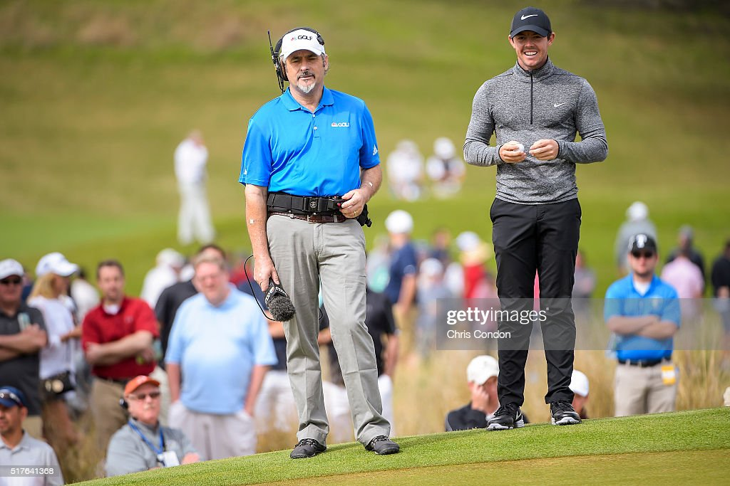 Rory McIlroy of Northern Ireland smiles as he speaks with David Feherty of Golf Channel on the 15th hole green during the fourth round of the World...