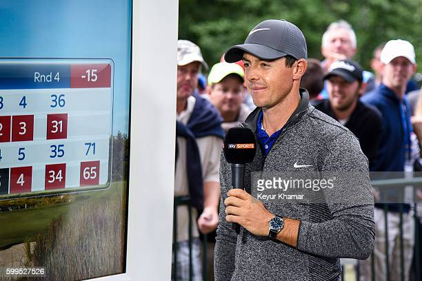 Rory McIlroy of Northern Ireland smiles during a Sky Sports interview following his two stroke victory in the final round of the Deutsche Bank...