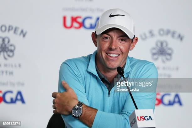 Rory McIlroy of Northern Ireland speaks during a press conference during a practice round prior to the 2017 US Open at Erin Hills on June 13 2017 in...
