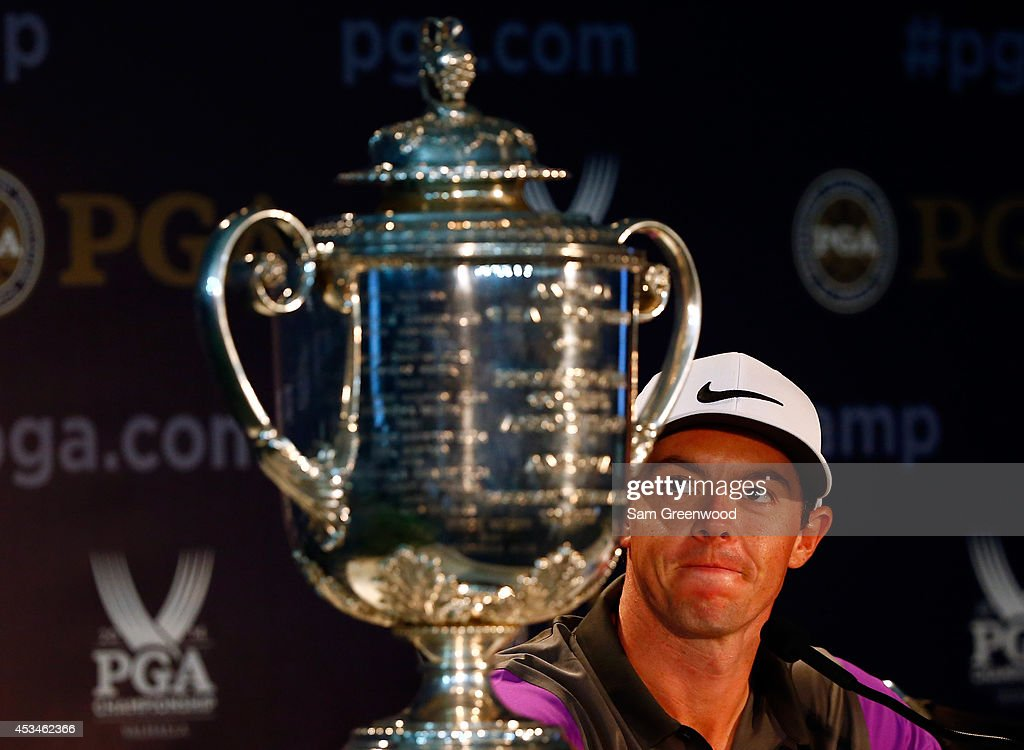 Rory McIlroy of Northern Ireland speaks with the media alongside the Wanamaker trophy after his onestroke victory during the final round of the 96th...