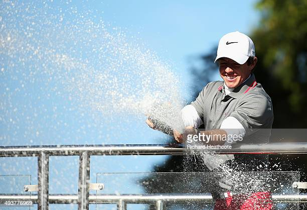 Rory McIlroy of Northern Ireland sprays champagne following his victory at the end of day four of the BMW PGA Championship at Wentworth on May 25...