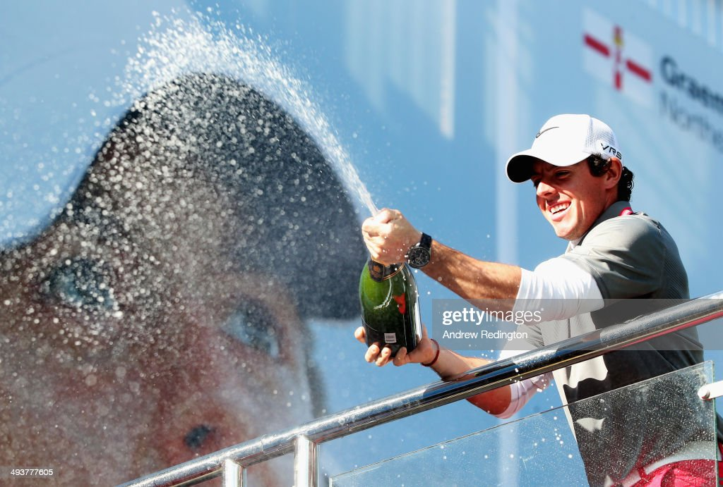 <a gi-track='captionPersonalityLinkClicked' href=/galleries/search?phrase=Rory+McIlroy&family=editorial&specificpeople=783109 ng-click='$event.stopPropagation()'>Rory McIlroy</a> of Northern Ireland sprays champagne following his victory at the end of day four of the BMW PGA Championship at Wentworth on May 25, 2014 in Virginia Water, England.