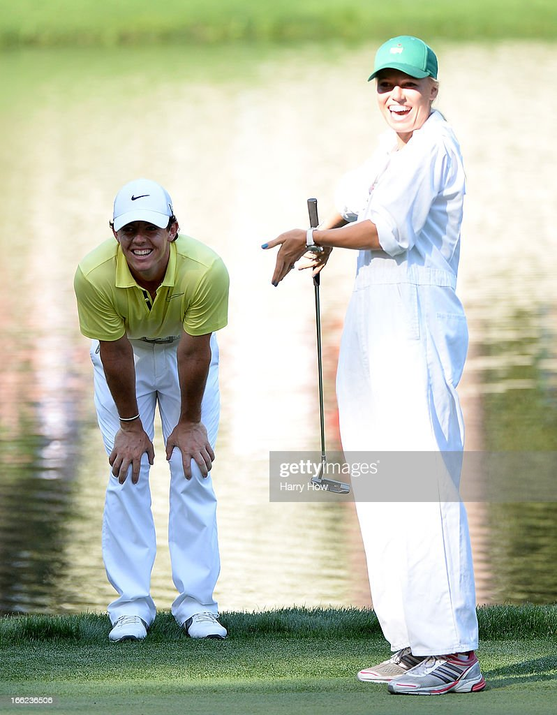<a gi-track='captionPersonalityLinkClicked' href=/galleries/search?phrase=Rory+McIlroy&family=editorial&specificpeople=783109 ng-click='$event.stopPropagation()'>Rory McIlroy</a> of Northern Ireland stands with his caddie <a gi-track='captionPersonalityLinkClicked' href=/galleries/search?phrase=Caroline+Wozniacki&family=editorial&specificpeople=740679 ng-click='$event.stopPropagation()'>Caroline Wozniacki</a> during the Par 3 Contest prior to the start of the 2013 Masters Tournament at Augusta National Golf Club on April 10, 2013 in Augusta, Georgia.