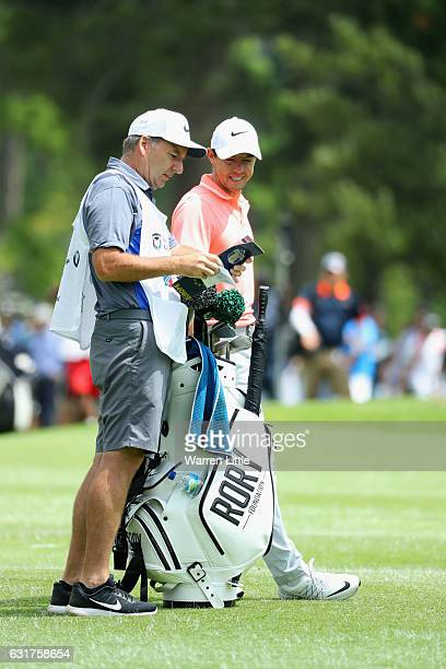 Rory McIlroy of Northern Ireland stands with his caddie JP Fitzgerald during the final round of the BMW South African Open Championship at Glendower...