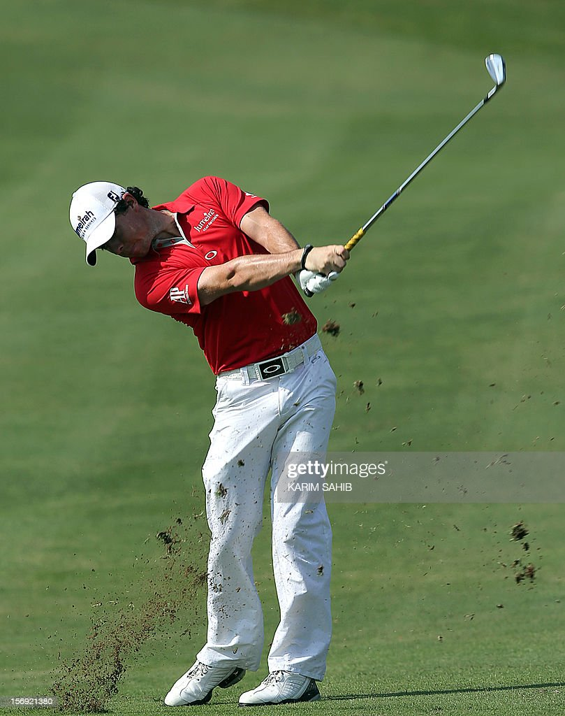 Rory McIlroy of Northern Ireland swings his club during the 4rd round of the DP World Tour Championship in the Gulf emirate of Dubai on November 25, 2012. The European Tour's finest have converged on the Greg Norman-designed Earth Course at Jumeirah Golf Estates in Dubai this week aiming to prevent a McIlroy sweep at the season-ending eight million dollar (6.2 million euros) championship.
