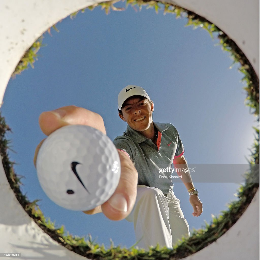 <a gi-track='captionPersonalityLinkClicked' href=/galleries/search?phrase=Rory+McIlroy&family=editorial&specificpeople=783109 ng-click='$event.stopPropagation()'>Rory McIlroy</a> of Northern Ireland takes a ball out of the hole on the practice putting gree during the third round of the Omega Dubai Desert Classic at the Emirates Golf Club on January 31, 2015 in Dubai, United Arab Emirates.