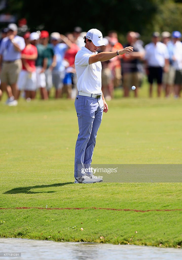 <a gi-track='captionPersonalityLinkClicked' href=/galleries/search?phrase=Rory+McIlroy&family=editorial&specificpeople=783109 ng-click='$event.stopPropagation()'>Rory McIlroy</a> of Northern Ireland takes a drop after hitting into the water on the first hole during the second round of the World Golf Championships-Cadillac Championship at Trump National Doral on March 7, 2014 in Doral, Florida.