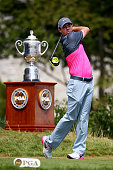 Rory McIlroy of Northern Ireland takes a practice swing on the first tee in front of the Wanamaker trophy during the final round of the 2015 PGA...