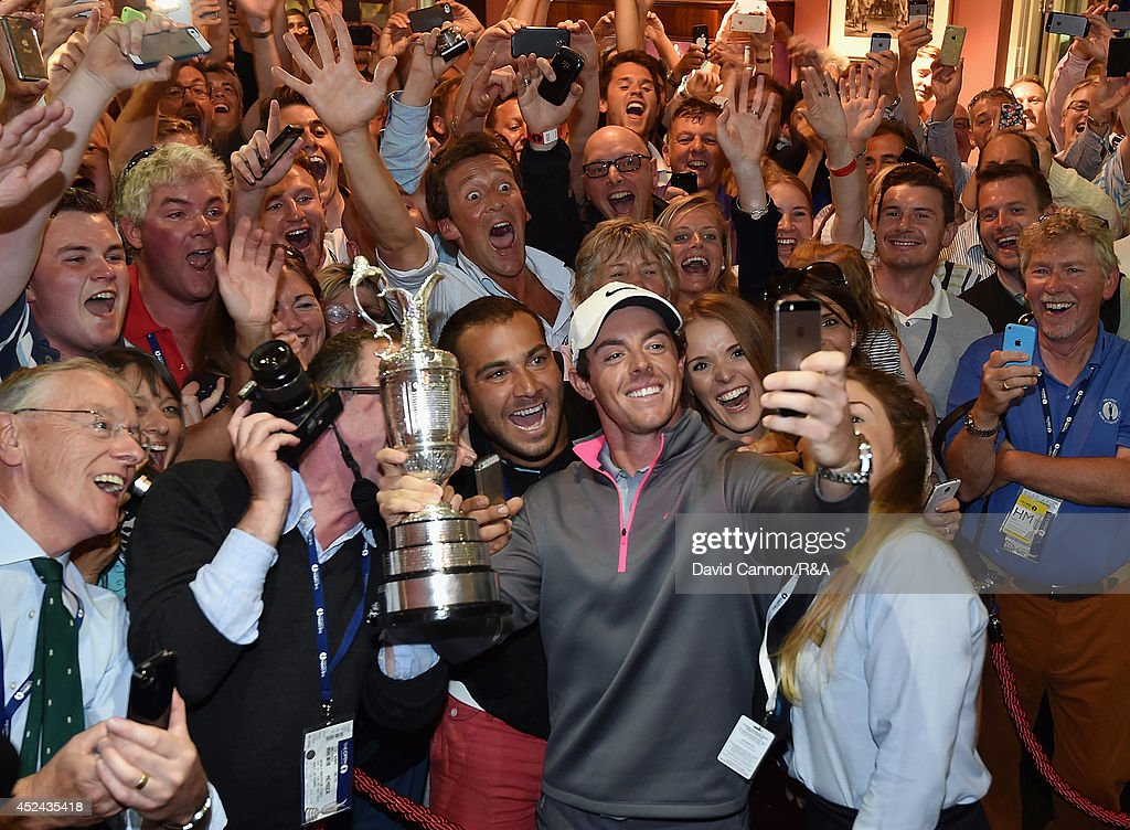 <a gi-track='captionPersonalityLinkClicked' href=/galleries/search?phrase=Rory+McIlroy&family=editorial&specificpeople=783109 ng-click='$event.stopPropagation()'>Rory McIlroy</a> of Northern Ireland takes a selfie with the Claret Jug and members of Royal Liverpool in the clubhouse after his two-stroke victory in The 143rd Open Championship at Royal Liverpool on July 20, 2014 in Hoylake, England.