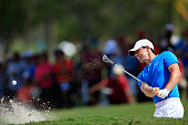 Rory McIlroy of Northern Ireland takes his second shot on the fourth hole during the second round of the World Golf ChampionshipsCadillac...
