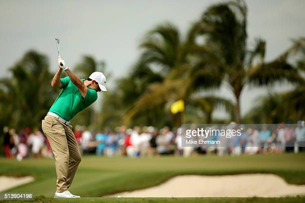 Rory McIlroy of Northern Ireland takes his shot on the second hole during the third round of the World Golf ChampionshipsCadillac Championship at...