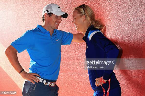 Rory McIlroy of Northern Ireland talks to his fiance Caroline Wozniacki of Denmark after coming joint second after the final round of the Abu Dhabi...