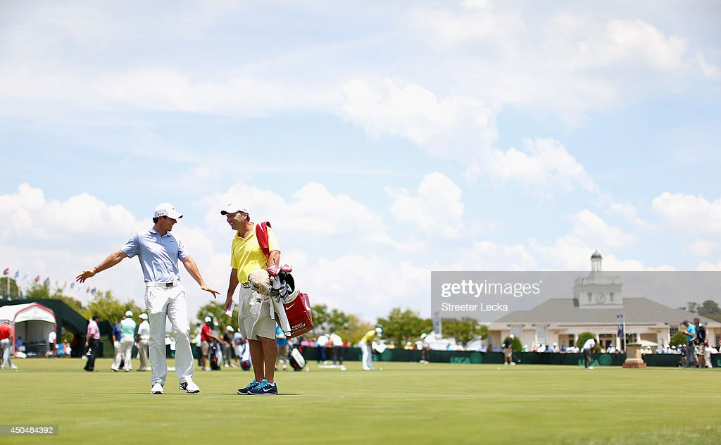 Rory McIlroy of Northern Ireland talks with caddie J.P. Fitzgerald on the practice range during a practice round prior to the start of the 114th U.S. Open at Pinehurst Resort & Country Club, Course No. 2 on June 11, 2014 in Pinehurst, North Carolina.