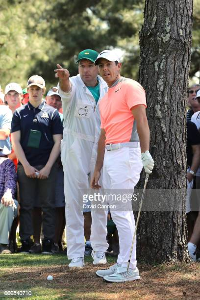Rory McIlroy of Northern Ireland talks with caddie JP Fitzgerald before plays his second shot on the first hole during the final round of the 2017...