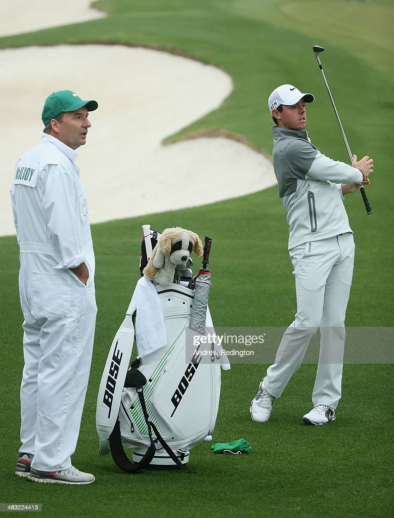 Rory McIlroy of Northern Ireland talks with his caddie, J. P. Fitzgerald, during a practice round prior to the start of the 2014 Masters Tournament at Augusta National Golf Club on April 7, 2014 in Augusta, Georgia.