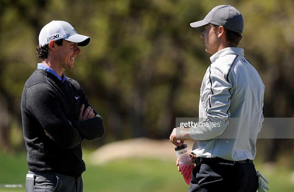 Rory McIlroy of Northern Ireland talks with Jordan Spieth on the 6th hole during the first round of the Valero Texas Open at the AT&T Oaks Course at TPC San Antonio on April 04, 2013 in San Antonio, Texas.