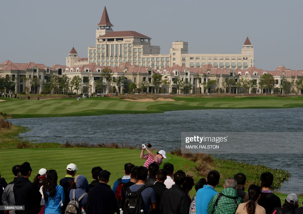 Rory McIlroy of Northern Ireland tees off at the 9th hole during day one the BMW Shanghai Masters golf tournament at the Lake Malaren Golf Club in Shanghai on October 24, 2013. The 7 million USD event is being held for the second time at the Lake Malaren Golf Club. AFP PHOTO/Mark RALSTON