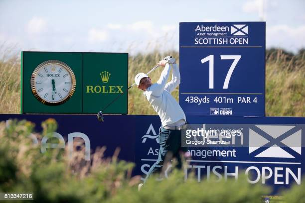 Rory McIlroy of Northern Ireland tees off on the 17th hole during a ProAm prior to the AAM Scottish Open at Dundonald Links Golf Course on July 12...
