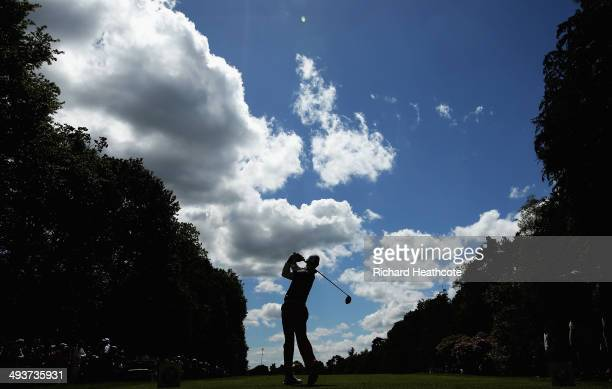 Rory McIlroy of Northern Ireland tees off on the 4th hole during day four of the BMW PGA Championship at Wentworth on May 25 2014 in Virginia Water...
