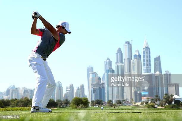 Rory McIlroy of Northern Ireland tees off on the eighth hole during the third round of the Omega Dubai Desert Classic on the Majlis Course at the...