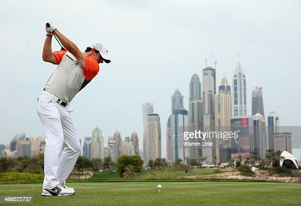 Rory McIlroy of Northern Ireland tees off on the eighth hole during the final round of the 2014 Omega Dubai Desert Classic on the Majlis Course at...