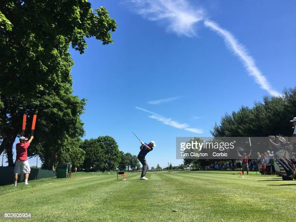 Rory McIlroy of Northern Ireland tees off on the ninth during the fourth round of the Travelers Championship Tournament at the TPC River Highlands...
