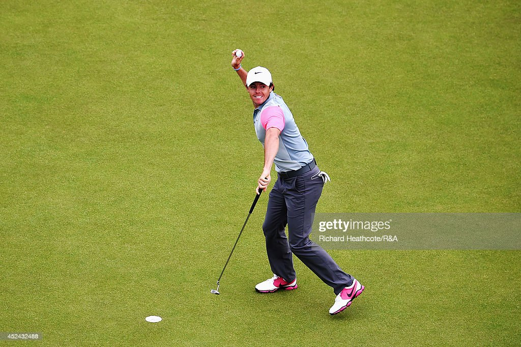 <a gi-track='captionPersonalityLinkClicked' href=/galleries/search?phrase=Rory+McIlroy&family=editorial&specificpeople=783109 ng-click='$event.stopPropagation()'>Rory McIlroy</a> of Northern Ireland throws his ball into the crowd following his two-stroke victory on the 18th green during the final round of The 143rd Open Championship at Royal Liverpool on July 20, 2014 in Hoylake, England.