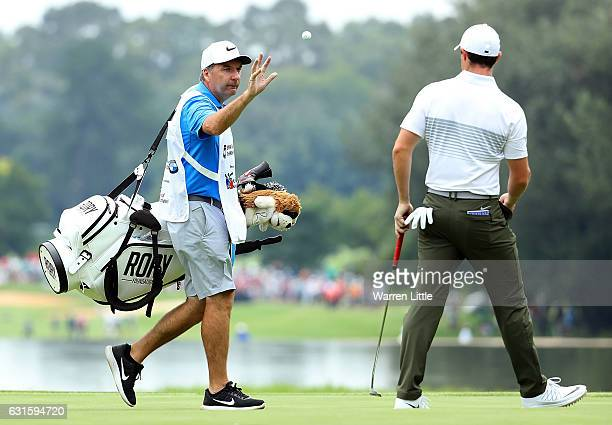 Rory McIlroy of Northern Ireland throws his ball to his caddy JP Fitzgerald during day two of The BMW South African Open Championship at Glendower...