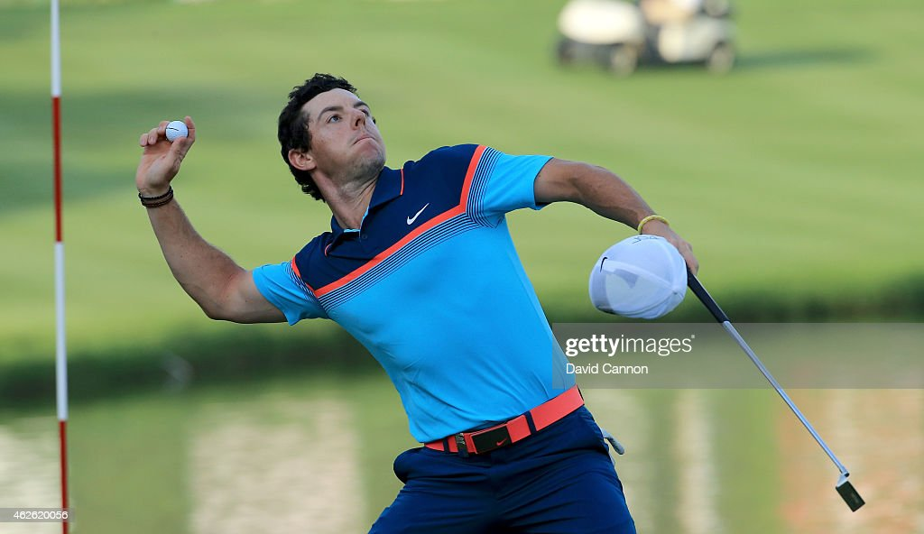 Rory McIlroy of Northern Ireland throws his ball to the crowd after he had holed the winning putt on the par 5 18th green during the final round of...