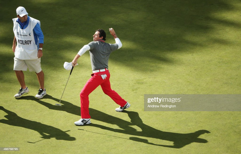 <a gi-track='captionPersonalityLinkClicked' href=/galleries/search?phrase=Rory+McIlroy&family=editorial&specificpeople=783109 ng-click='$event.stopPropagation()'>Rory McIlroy</a> of Northern Ireland throws his ball to the crowd after holing a birdie putt on the 18th green during day four of the BMW PGA Championship at Wentworth on May 25, 2014 in Virginia Water, England.