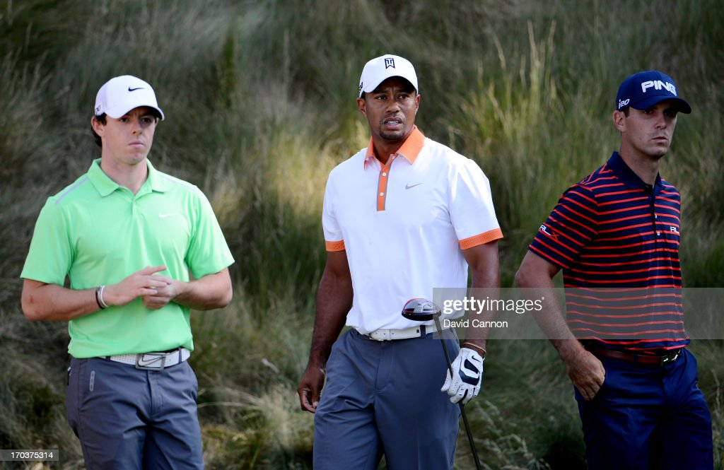<a gi-track='captionPersonalityLinkClicked' href=/galleries/search?phrase=Rory+McIlroy&family=editorial&specificpeople=783109 ng-click='$event.stopPropagation()'>Rory McIlroy</a> of Northern Ireland, <a gi-track='captionPersonalityLinkClicked' href=/galleries/search?phrase=Tiger+Woods&family=editorial&specificpeople=157537 ng-click='$event.stopPropagation()'>Tiger Woods</a> of the United States and <a gi-track='captionPersonalityLinkClicked' href=/galleries/search?phrase=Billy+Horschel&family=editorial&specificpeople=565390 ng-click='$event.stopPropagation()'>Billy Horschel</a> of the United States wait on a tee box during a practice round prior to the start of the 113th U.S. Open at Merion Golf Club on June 12, 2013 in Ardmore, Pennsylvania.