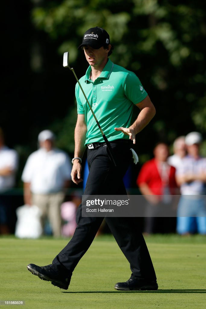 <a gi-track='captionPersonalityLinkClicked' href=/galleries/search?phrase=Rory+McIlroy&family=editorial&specificpeople=783109 ng-click='$event.stopPropagation()'>Rory McIlroy</a> of Northern Ireland tosses his putter on the 11th hole green during the third round of the BMW Championship at Crooked Stick Golf Club on September 8, 2012 in Carmel, Indiana.