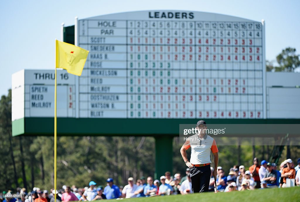 <a gi-track='captionPersonalityLinkClicked' href=/galleries/search?phrase=Rory+McIlroy&family=editorial&specificpeople=783109 ng-click='$event.stopPropagation()'>Rory McIlroy</a> of Northern Ireland waits on the 18th green during the first round of the 2014 Masters Tournament at Augusta National Golf Club on April 10, 2014 in Augusta, Georgia.