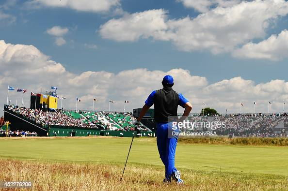 Rory McIlroy of Northern Ireland waits to hit his second shot on the 18th hole during the first round of The 143rd Open Championship at Royal...