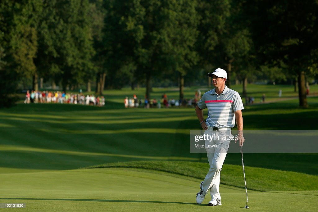 Rory McIlroy of Northern Ireland waits to putt on the 18th green during the final round of the World Golf Championships-Bridgestone Invitational at Firestone Country Club South Course on August 3, 2014 in Akron, Ohio.