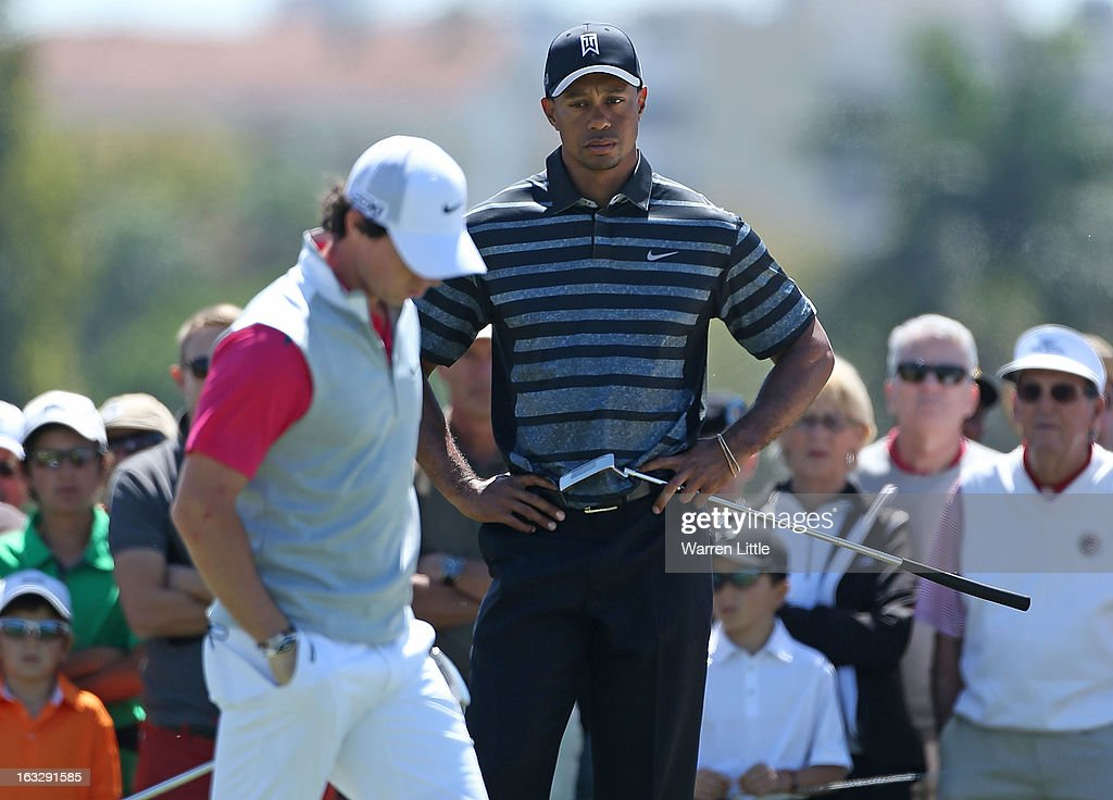 Rory McIlroy of Northern Ireland (L) waits with <a gi-track='captionPersonalityLinkClicked' href=/galleries/search?phrase=Tiger+Woods&family=editorial&specificpeople=157537 ng-click='$event.stopPropagation()'>Tiger Woods</a> on the 11th green during the first round of the WGC-Cadillac Championship at the Trump Doral Golf Resort & Spa in Miami, Florida.