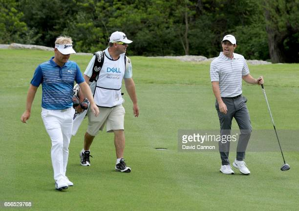 Rory McIlroy of Northern Ireland walking with his opponent Soren Kjeldsen of Denmark on the second hole during the first round of the 2017 Dell Match...