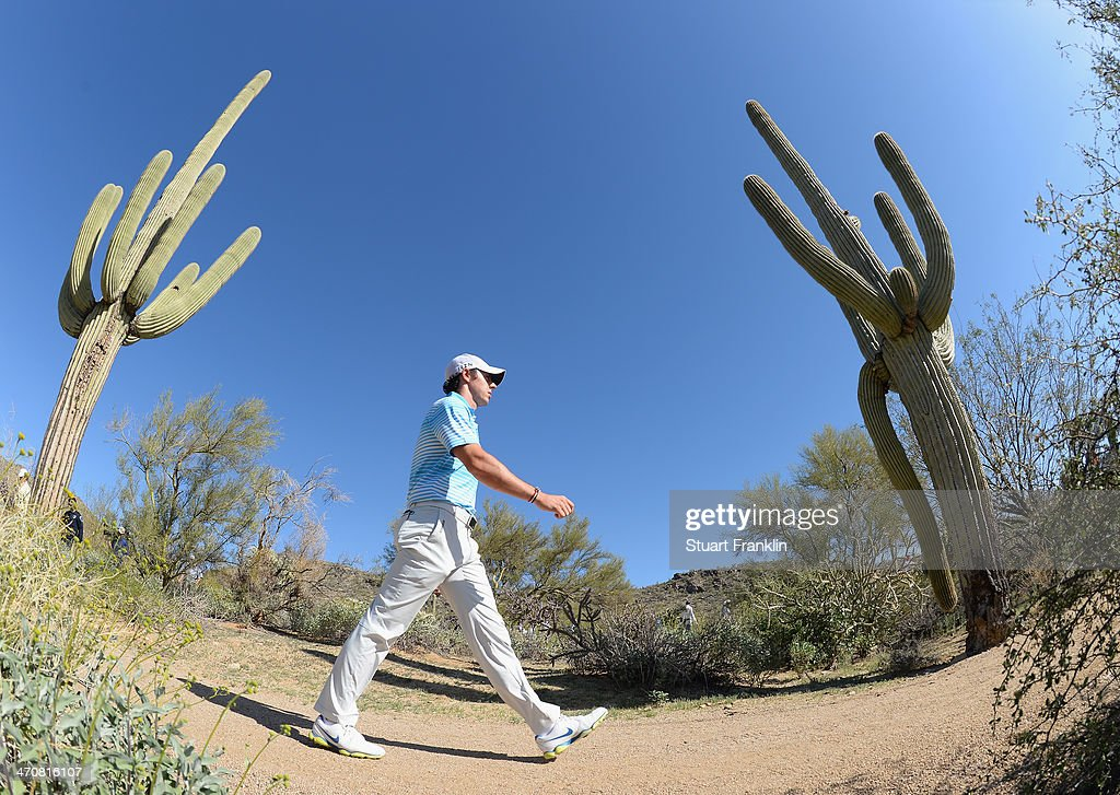 <a gi-track='captionPersonalityLinkClicked' href=/galleries/search?phrase=Rory+McIlroy&family=editorial&specificpeople=783109 ng-click='$event.stopPropagation()'>Rory McIlroy</a> of Northern Ireland walks between holes during the second round of the World Golf Championships - Accenture Match Play Championship at The Golf Club at Dove Mountain on February 20, 2014 in Marana, Arizona.