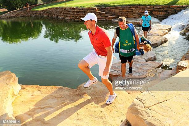 Rory McIlroy of Northern Ireland walks down the 6th hole with caddie JP Fitzgerald during a proam round ahead of the DP World Tour Championship at...