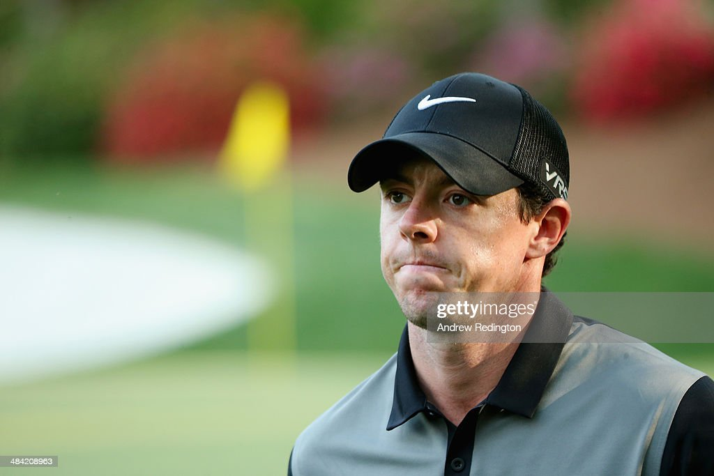<a gi-track='captionPersonalityLinkClicked' href=/galleries/search?phrase=Rory+McIlroy&family=editorial&specificpeople=783109 ng-click='$event.stopPropagation()'>Rory McIlroy</a> of Northern Ireland walks off of the 13th green during the second round of the 2014 Masters Tournament at Augusta National Golf Club on April 11, 2014 in Augusta, Georgia.