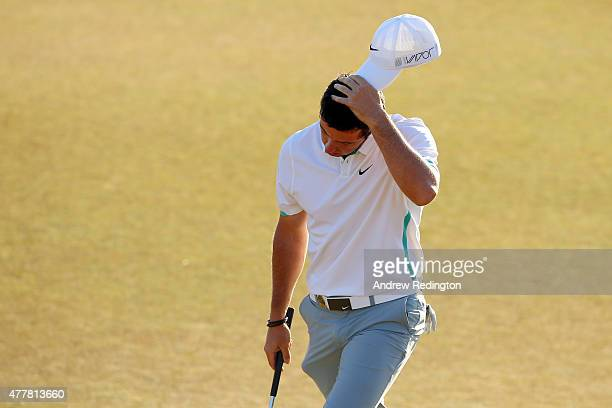 Rory McIlroy of Northern Ireland walks off the 18th green during the second round of the 115th US Open Championship at Chambers Bay on June 19 2015...