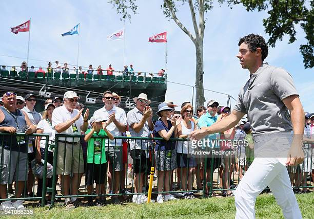 Rory McIlroy of Northern Ireland walks off the ninth green after finiishing the continuation of the second round of the US Open at Oakmont Country...