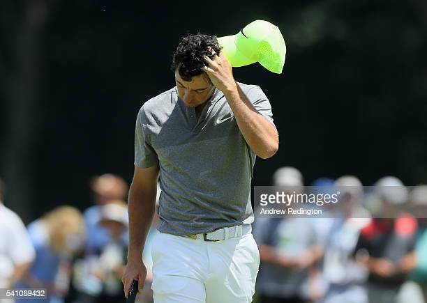 Rory McIlroy of Northern Ireland walks off the ninth green after finishing the continuation of the second round of the US Open at Oakmont Country...