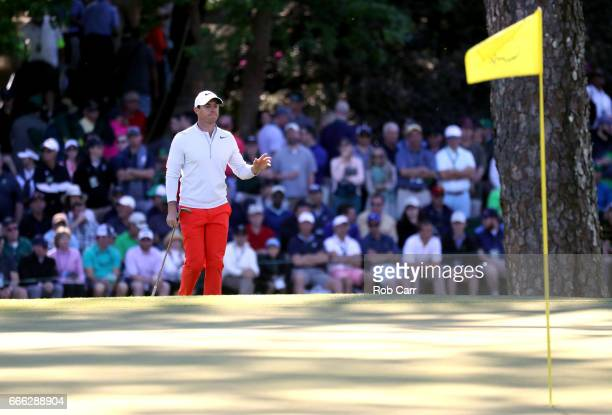 Rory McIlroy of Northern Ireland walks onto the 15th green during the third round of the 2017 Masters Tournament at Augusta National Golf Club on...