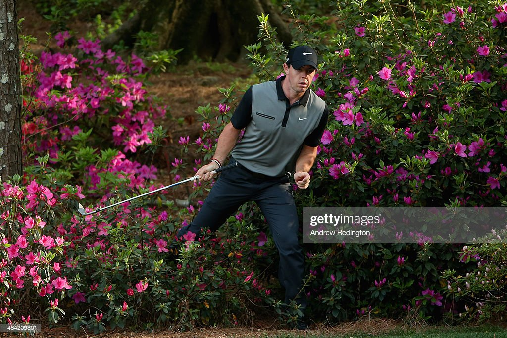 Rory McIlroy of Northern Ireland walks out of the azaleas bushes behind the 13th green after hitting a shot during the second round of the 2014 Masters Tournament at Augusta National Golf Club on April 11, 2014 in Augusta, Georgia.