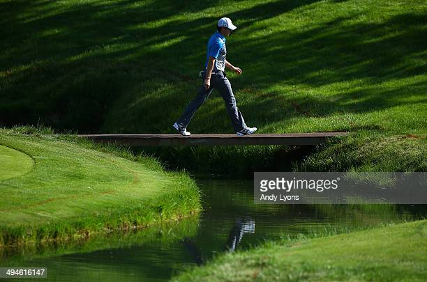 Rory McIlroy of Northern Ireland walks over a bridge on the 14th hole during the second round of the Memorial Tournament presented by Nationwide...